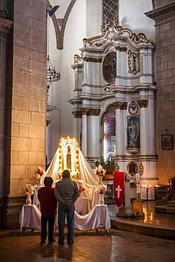 Praying, San Francisco church, Potosi, Bolivia