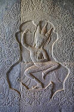 Aspara sculpture in bas-relief on the wall, in Angkor Wat, Siem Reap, Cambodia
