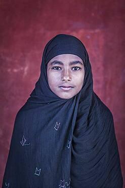 Portrait of a muslim girl, in Jama Masjid mosque, Delhi, India