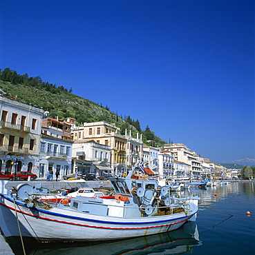 Boats and buildings on the waterfront in the seaside market and port town of Neapoli, Peloponnese, Greece, Europe