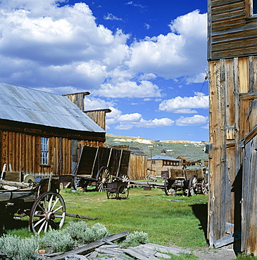 Wooden buildings and carts at Bodie, Ghost Town, Bodie State Historic Park, California, United States of America (USA), North America