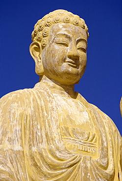 Close-up of the statue of the Buddha at Nhu Lai Temple, Vung Tau Peninsula, Vietnam, Indochina, Southeast Asia, Asia