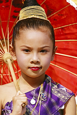 Young Laotian girl in traditional dress holding a red parasol, Laos, Indochina, Southeast Asia, Asia
