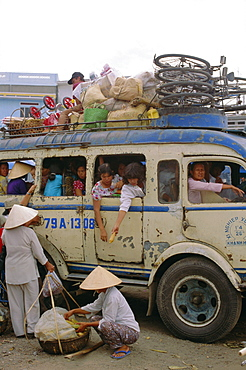Crowded bus with bicycles, sacks and passengers on roof, city bus terminal, Nha Trang, Vietnam, Indochina, Southeast Asia, Asia