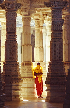 Jain covering his mouth in the interior of the Adinath Temple complex, Ranakpur, Rajasthan, India