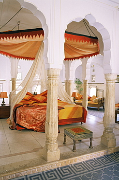 Traditional Rajput columns and cuspid arches in tented guest bedroom, Samode Palace Hotel, Samode, Rajasthan state, India, Asia