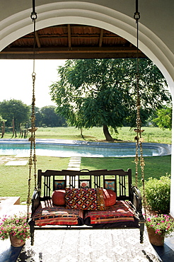 A swing chair Hitchkar traditional and particular to Gujarat, plus traditional fabrics in a residential home, near Ahmedabad, Gujarat state, India, Asia