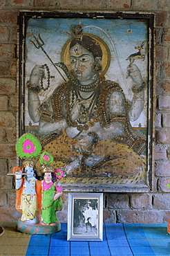 Painting of Krishna on glass, and photograph of Gandhi, in 1970s concrete structured home, Ahmedabad, Gujarat state, India, Asia