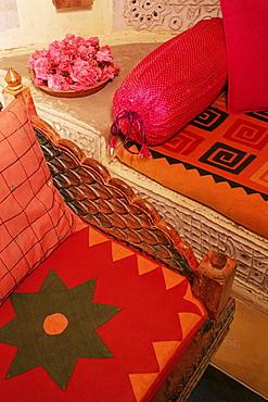 Bright furnishings in modern residential home in traditional tribal Rabari round mud hut, Bunga style, near Ahmedabad, Gujarat state, India, Asia