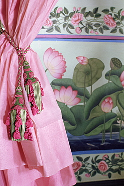 Tassels, pink curtains and painted walls, the Shiv Niwas Palace Hotel, Udaipur, Rajasthan state, India, Asia