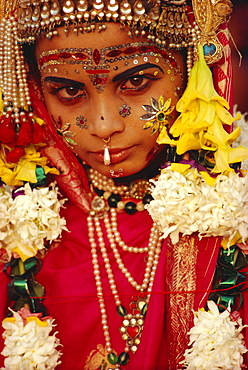 Portrait of a young actor in jewels and make-up as Sita, wife of Rama, from the Ramlilla, the stage play of the great Hindu Epic, the Ramayana, Varanasi (Benares), Uttar Pradesh State, India