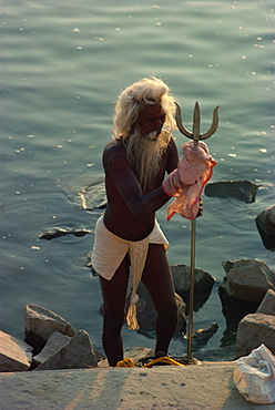 Sadhu with trident, a symbol of the god Vishnu, Varanasi, Uttar Pradesh state, India, Asia