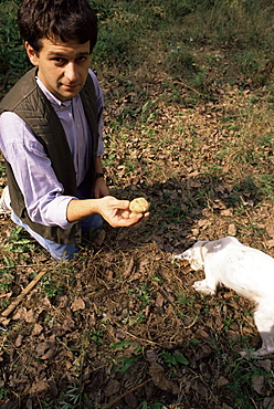 Paulo Cerutti with truffle and Diana the dog, Monta d'Alba, Barolo, Piemonte (Piedmont), Italy, Europe