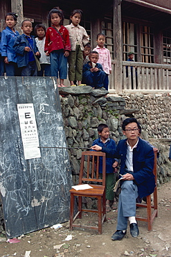 Eye testing in a Dong village school, China, Asia