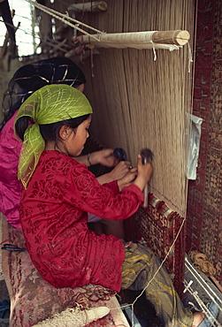 Uyghur children learning to make carpets, Hotan, China, Asia