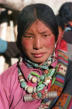 Portrait of a Tibetan nomad woman with turquoise and silver jewellery, at Tongren, Qinghai, China, Asia - 188-5500
