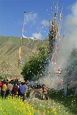 Renewing prayer flags at Labrang, Gansu, China, Asia