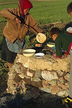 Kazak cooking bread, Tianshan, Xinjiang, China, Asia