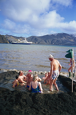 Tourists bathing in warm volcanic waters, Deception Island, South Shetland Islands, Antarctica, Polar Regions