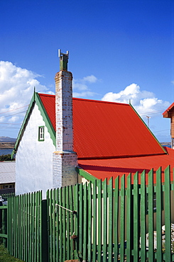 A private house with red corrugated roof and green fence in Stanley, capital of the Falkland Islands, South America