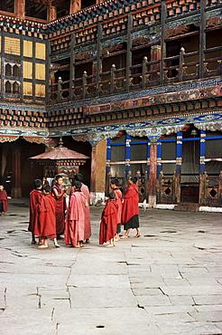 Novice monks in Rimpong Dzong (monastery), Paro, Bhutan, Asia