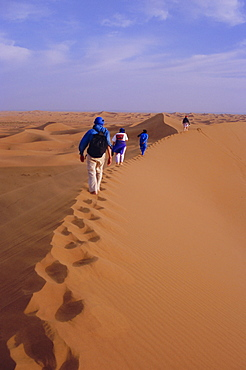 Party of trekkers on top of dunes at Chigaga, Draa Valley, Morocco, North Africa