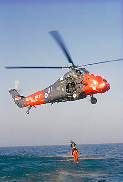 Wessex helicopter winching up survivior in rescue from sea