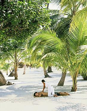 Man having a massage on the beach, Southeast Asia, Asia