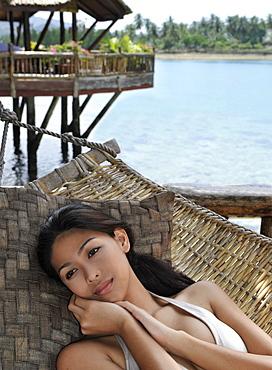 Girl on hammock, Pearl Farm Resort on Samar Island in Davao, Mindanao, Philippines, Southeast Asia, Asia
