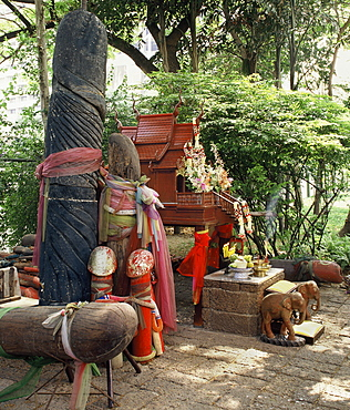 The shrine to Tub Tim, a spirit supposed to enhance fertility for couples and grant a great variety of wishes. Nai Lert Park, Bangkok Thailand, Southeast Asia, Asia
