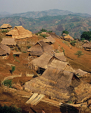 Akha hill tribe village, with deforested hills destroyed by slash and burn farming by tribes in the background, Chiang Rai province, Thailand, Southeast Asia, Asia