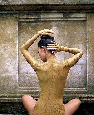 Woman having a lulur (turmeric) scrub at a spa in Bali, Indonesia, Southeast Asia, Asia