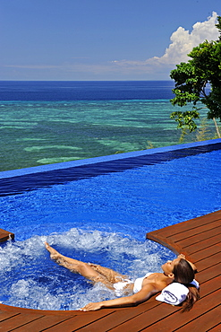 Girl in the jacuzi, Esacaia Resort and Spa, Bohol, Philippines, Southeast Asia, Asia