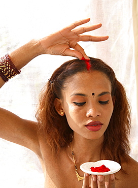 Girl with sindoor, a red powder used by married woman, at Shreyas Retreat, Bangalore, India, Asia