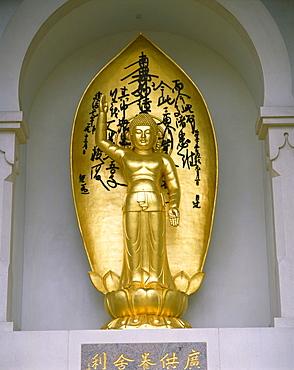Statue of Buddha at the Buddhist Peace Pagoda, Battersea Park, London, England, United Kingdom, Europe