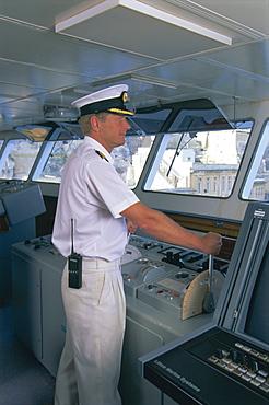 Ship's captain on the bridge, cruise ship