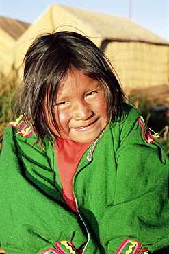 Head and shoulders portrait of a Uros Indian girl on floating reed island, Islas Flotantes, Lake Titicaca, Peru, South America