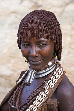 Portrait of a woman of the Hamer tribe, her hair treated with ochre, water and resin and twisted into tresses known as goscha, Lower Omo Valley, Southern Ethiopia, Africa - 252-11047