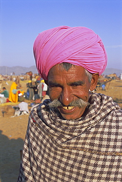 Portrait of a man in a colourful pink turban, Pushkar, Rajasthan State, India, Asia