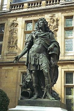 Statue of Louis XIV outside the Renaissance building of the Hotel Carnavalet, Le Marais, Paris, France, Europe