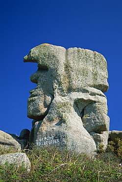 Faces in the rocks, Le Pere Trebeurden, at Trebeurden on the Cote de Granit Rose on the Cotes d'Amor, Brittany, France, Europe
