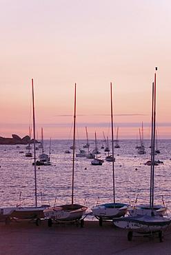 Sunset over boats, Tregastel, Cote de Granit Rose, Cotes d'Armor, Brittany, France, Europe