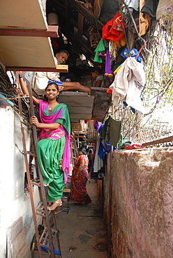 Narrow street and 2-layer houses, Colaba fishing village, southern end of Mumbai city, Maharashtra, India, Asia