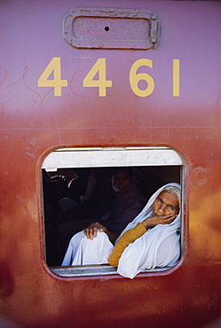 Woman on a train at the railway station, Bhopal, Madhya Pradesh State, India, Asia
