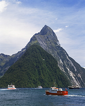 Small boats in the water of Milford Sound in front of Mitre Peak, Otago, South Island, New Zealand, Pacific