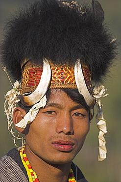 Naga man wearing headdress made of woven cane decorated with wild boar teeth and bear fur, Naga New Year Festival, Lahe village, Sagaing Division, Myanmar (Burma), Asia