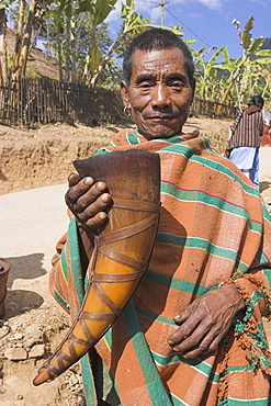 Naga man with horn used as drinking vessel, Naga New Year Festival, Lahe village, Sagaing Division, Myanmar (Burma), Asia