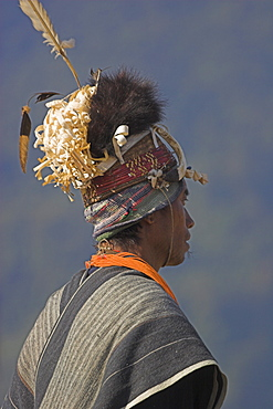 Naga man in headdress of woven cane decorated with wild boar's teeth, bear fur and topped with feathers, Naga New Year Festival, Lahe village, Sagaing Division, Myanmar (Burma), Asia