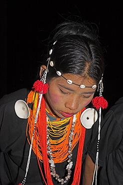Naga lady wearing conch shell earings dancing, Lahe village, Sagaing Division, Myanmar (Burma), Asia