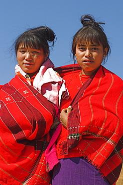 Naga (Macham tribe) girls wrapped up in their traditional blanket, Magyan Village, Sagaing Division, Myanmar (Burma), Asia